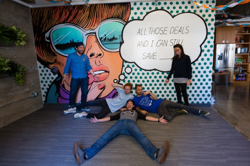 The mural painting team at Goodshop's Hackathon, in front of their mural!