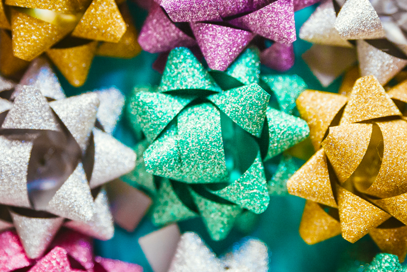 Colorful glitter bows on a gift